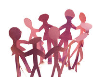 Paper People. A group of paper people dancing in a circle, isolated on a white background Stock Photos