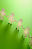 Paper people. Vertical image of chain of paper people Stock Photo