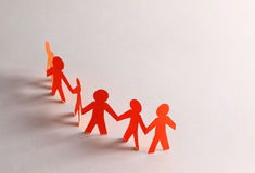 Paper people doing teamwork. In their business Royalty Free Stock Photos