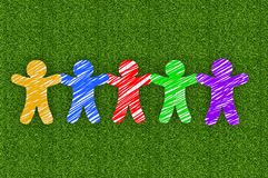 Paper people on green grass. Background Royalty Free Stock Photo