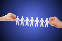 Paper people in hands royalty free stock photo