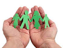 Paper people in hands Royalty Free Stock Images