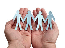 Paper people in hands Royalty Free Stock Photos