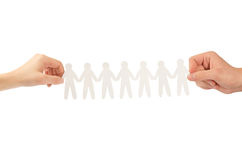 Paper people in hands Royalty Free Stock Image