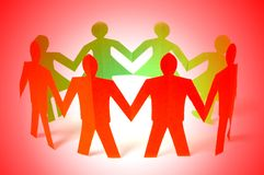 Paper people holding hands. Together Royalty Free Stock Images