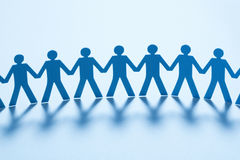 Paper people holding hands Royalty Free Stock Images