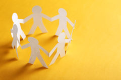 Paper people. On the orange paper background Stock Photo
