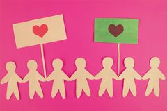 paper people on pink background. love valentaine day concept stock photography