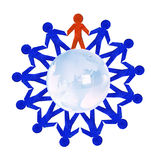 Paper people standing in a circle around glass globe Stock Photo
