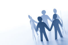 Paper people standing together hand in hand. Team stock photo