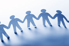 Paper people standing together hand in hand. Team Royalty Free Stock Photography