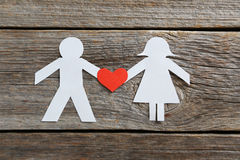 Paper people. Together in love on the grey wooden background Stock Photography