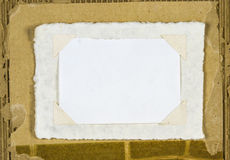 Paper picture frame on Cardboard Scrap Royalty Free Stock Photo