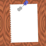 Paper with pin on brown wood texture Stock Images