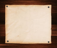 Paper Pinned to a Wooden Plank Royalty Free Stock Images