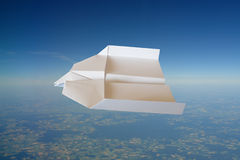 Paper plane. High over summer landscape royalty free stock images