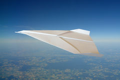 Paper plane. High over summer landscape royalty free stock photos