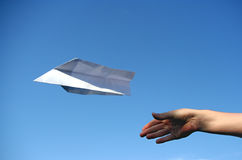Paper plane. A paper plane that was just thrown in the air. Symbolizes concepts like success, independence or freedom stock photo