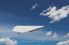 Paper plane. Flying on a background of the blue sky with beautiful clouds Stock Images