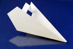 Paper plane. Folded paper plane over blue background royalty free stock images