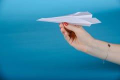 Paper plane, blue background Stock Photos