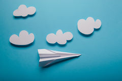 Paper plane, blue background Stock Images