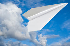 Paper plane in blue sky. Royalty Free Stock Image