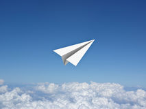 Paper plane in the blue sky above clouds. 3D rendering Royalty Free Stock Image