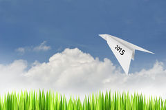 Paper plane on blue sky background. With happy new year 2015  concept Stock Photography