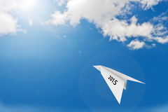 Paper plane on blue sky background. With happy new year 2015  concept Stock Image