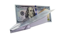 Paper plane with dollars on white background. Silver plane with a hundred dollars. The plane quickly and easily deliver the money Stock Image
