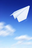 Paper plane flying Stock Photo