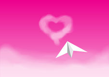 Paper plane flying in the pink sky Royalty Free Stock Photography