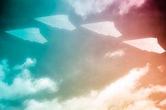 Paper plane flying in sky Stock Photo