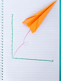 Paper plane graph up Stock Images