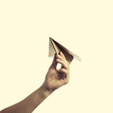 Paper plane 2. Isolated image of a hand starts the paper plane stock photography