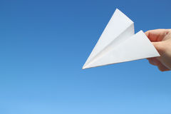 Paper plane and male hand start to fall Royalty Free Stock Image