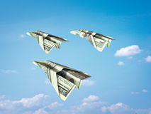 Paper plane money. Over the sky Royalty Free Stock Photos