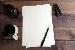 Paper plane, mug, spoon, stapler, black handle Royalty Free Stock Photo