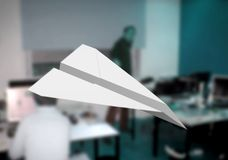 Paper plane in office Stock Photography