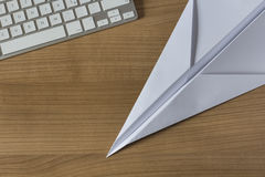 Paper Plane on an office desk Royalty Free Stock Photos
