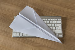 Paper Plane on an office desk Royalty Free Stock Images