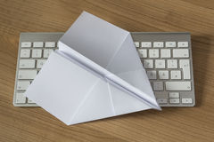 Paper Plane on an office desk Stock Images