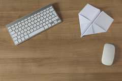 Paper Plane on an office desk Royalty Free Stock Photography