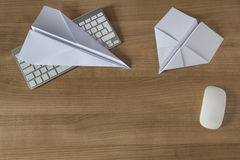 Paper Plane on an office desk Stock Image