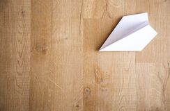 Paper Plane On Wooden Floor Royalty Free Stock Photography