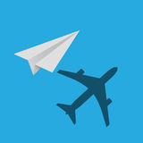 Paper plane with real plane shadow on blue background Royalty Free Stock Photos