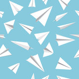 Paper plane seamless pattern. Seamless pattern with paper planes. White paper planes on a blue background Stock Images