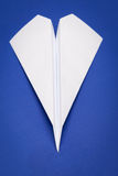 Paper plane. White paper plane on blue paper background Stock Photos
