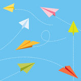 Paper planes. Flying in different directions in different colors Royalty Free Stock Image